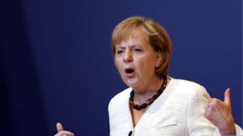 Μέρκελ: Η Ελλάδα πρέπει να τηρήσει τις δεσμεύσεις της