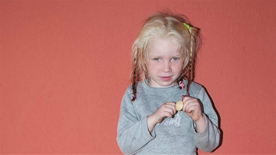 She was given to us by Bulgarian gypsies, the Roma couple says for little Maria