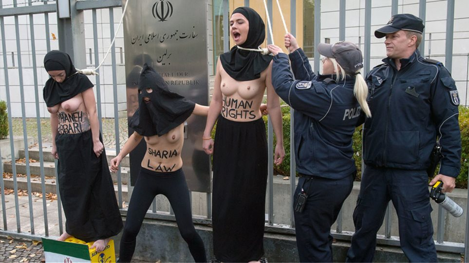 Femen: «Κρυφτοκυνηγητό» με την αστυνομία στους δρόμους του Παρισιού!