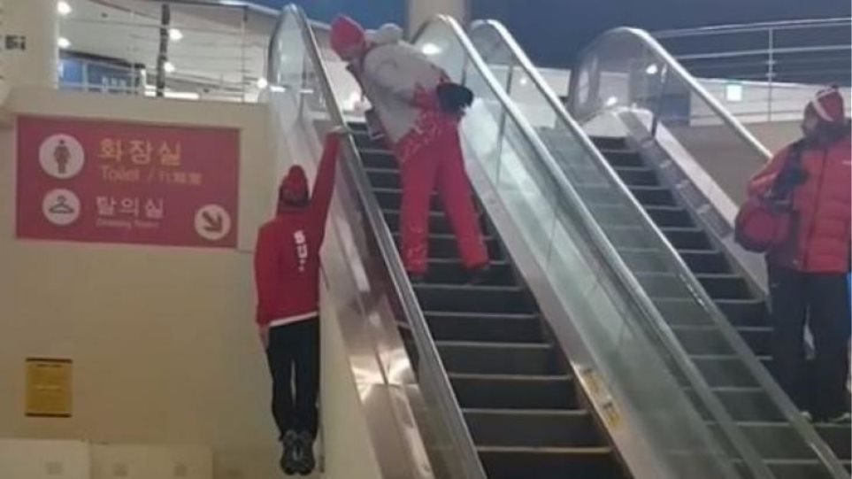 Swiss skier deserves a Gold medal for his hilarious escalator stunt (AMAZING VIDEOS)