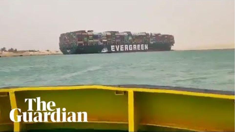Container ship runs aground in Suez Canal causing traffic jam