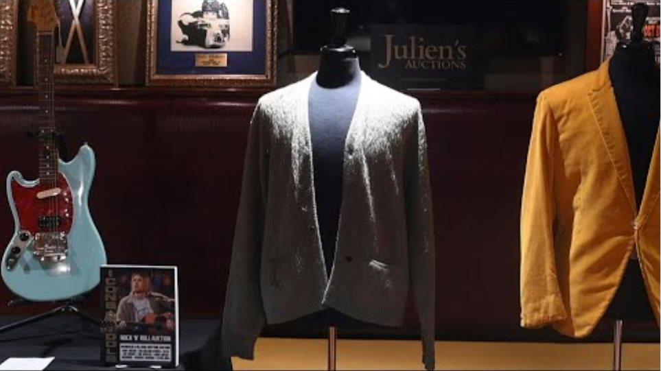 Cigarette-burned Kurt Cobain 'Unplugged' cardigan heading to auction | AFP
