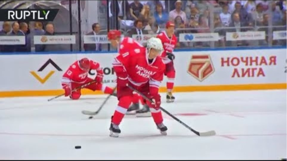 Putin hits the ice & shows off his hockey skills in Sochi