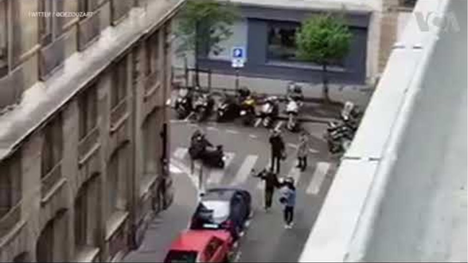 People running, body lying on floor after Paris stabbing