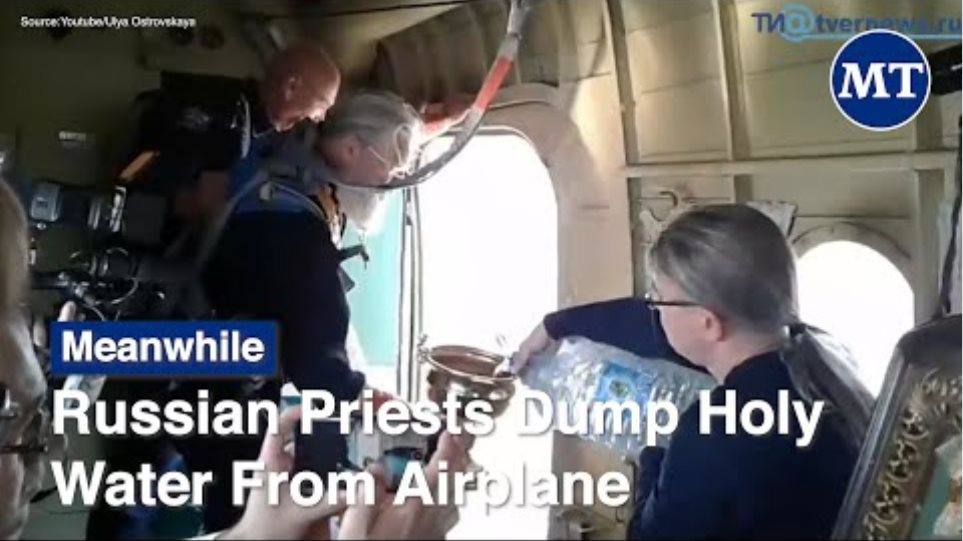 Russian Priests Dump Holy Water From Airplane | The Moscow Times