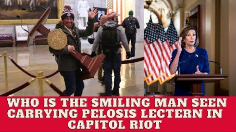 the smiling man seen carrying pelosis lectern in capitol riot