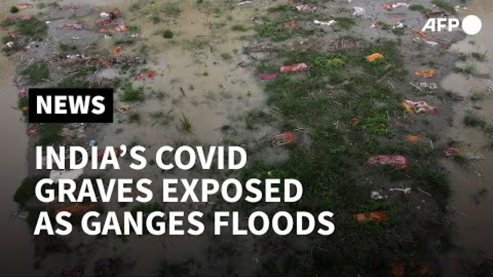 India's Covid graves exposed as Ganges river floods | AFP
